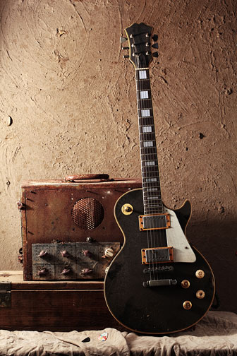 vintage guitar amp and electric guitar